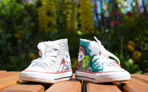 A pair of Supershoes sit on a wooden bench in front of a graffiti memorial at the Chelsea Show.